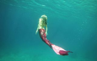 Island Mermaids Swimming with a Pink Mermaid Tail in Gili T
