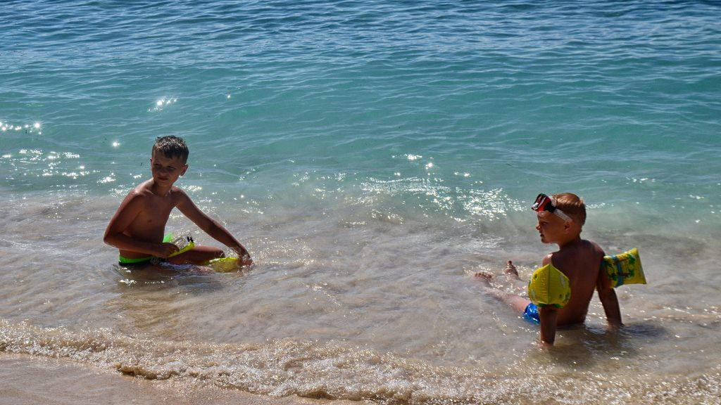 Kids swimming at Lombok safe beach