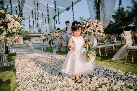 Phuket wedding flower girl walking down aisle