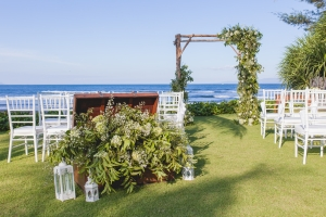 Bali beachfront wedding altar with vines