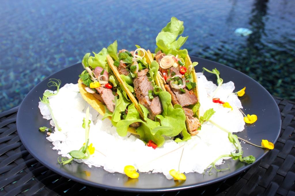 Spicy beef salad taco